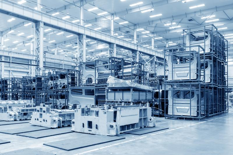 Automobile factory warehouse. The interior of a big industrial building or factory with steel constructions stock photos