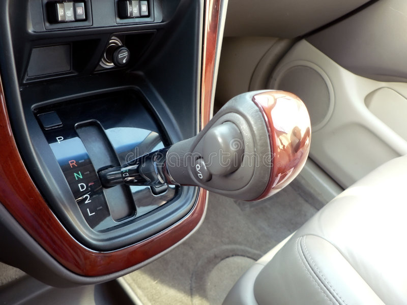 Automobile gear shift. Photo of a suv automobile manual gear shift in the drive position royalty free stock images