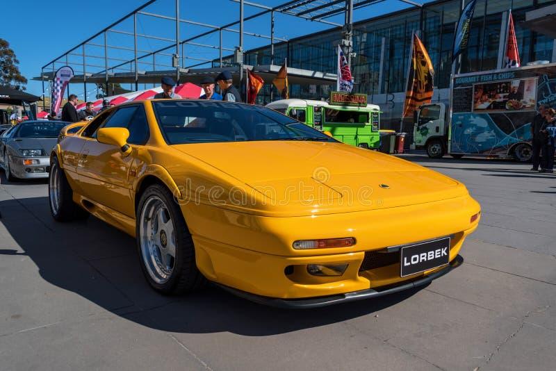 Automobile gialla d'annata di Lotus a Motorclassica fotografia stock libera da diritti