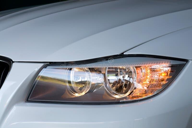 Automobile Headlight at Night. White Automobile Headlight at Night stock image