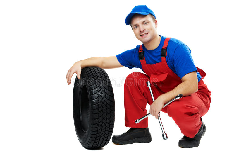 Download Automobile Mechanic With Car Tire And Spanner Stock Photo - Image: 21873254