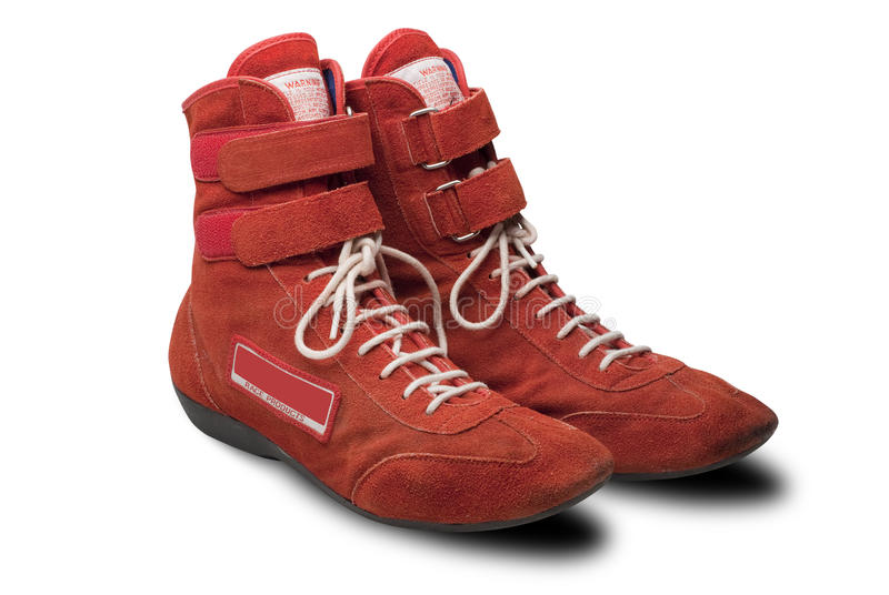 Automobile racing shoes isolated. Red swede racing shoes on white with shadow and clipping path stock image