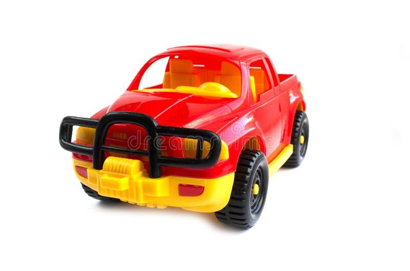 Automobile rossa del giocattolo Giocattolo del ` s dei bambini automobile rossa di plastica fotografia stock libera da diritti