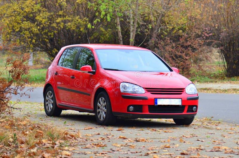 Automobile rossa di golf di Volkswagen GTI fotografia stock libera da diritti