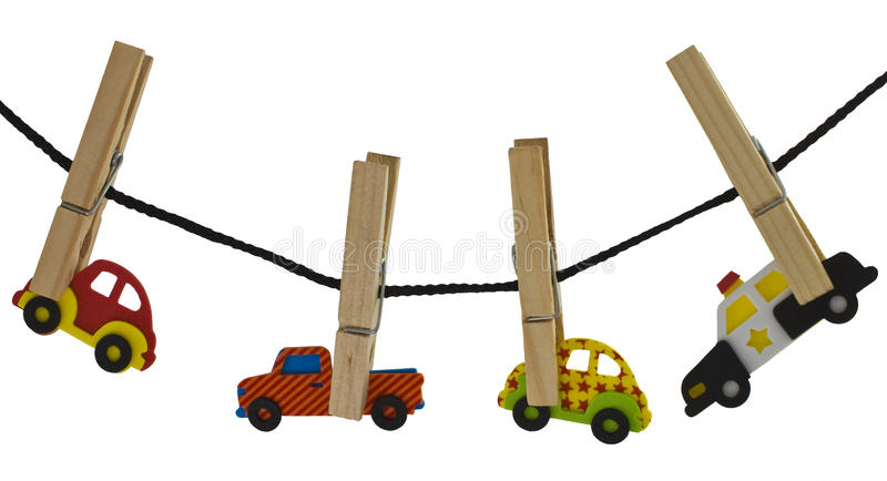 Automobiles on a clothes line. With a police car in the rear to show traffic and commuting. Isolated on a white background stock image