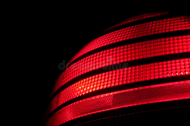 AutomobileTail Light. A red plastic automobile tail light signal stock photos