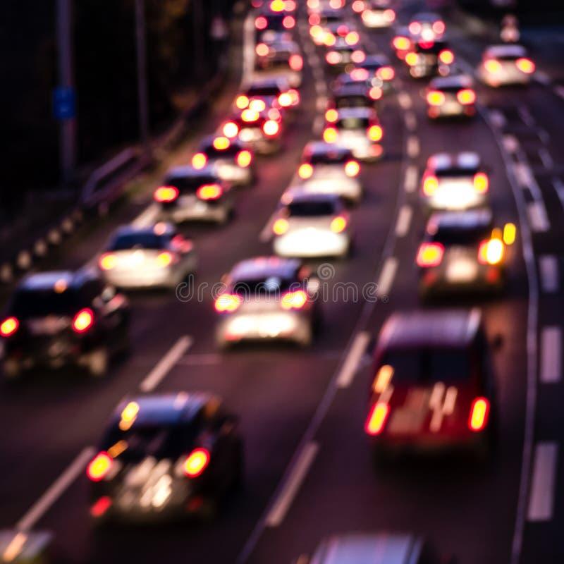 Automobili sulla strada principale (effetto del bokeh) immagine stock libera da diritti