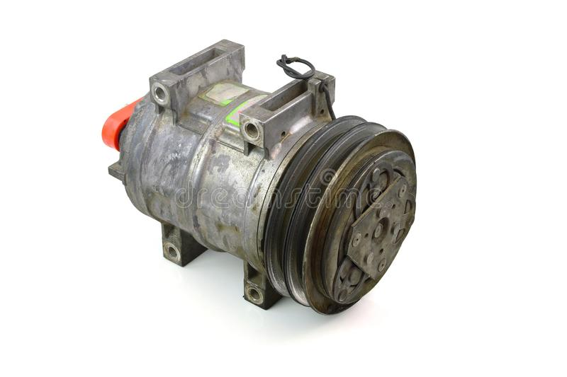 Automotive air conditioning compressor old on a white background. Automotive air conditioning compressor old on a white background stock image