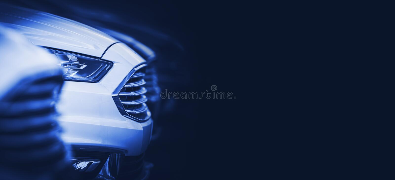 Automotive Blue Banner. Background with Modern Vehicles in Stock on the Dealership Parking Lot. Dark Blue Backdrop with Copy Space stock photo
