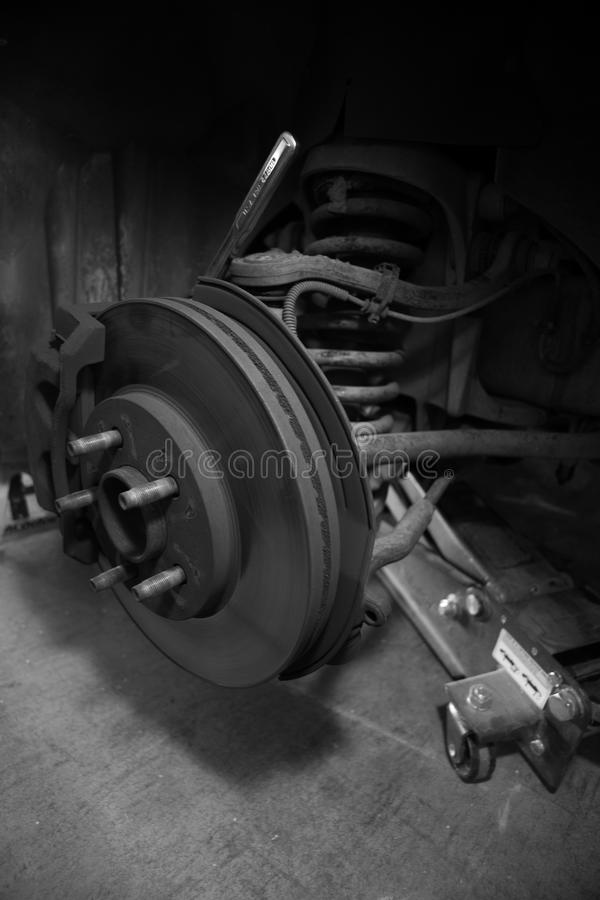 Automotive Brakes. Modern disk brakes being changed royalty free stock photo