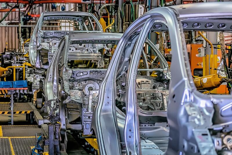 Automotive production lines revolutionized the automotive industry. They made building cars more efficient. Automotive production lines revolutionized the royalty free stock images