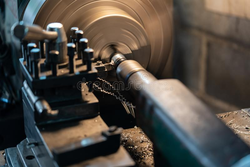 Automotive Rotating parts- metal lathe is a tool that rotates the workpiece about an axis of rotation to perform various operation. Automotive Rotating parts royalty free stock image