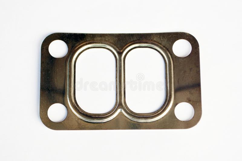 Automotive steel gasket for the. Exhaust system isolated on white stock photo