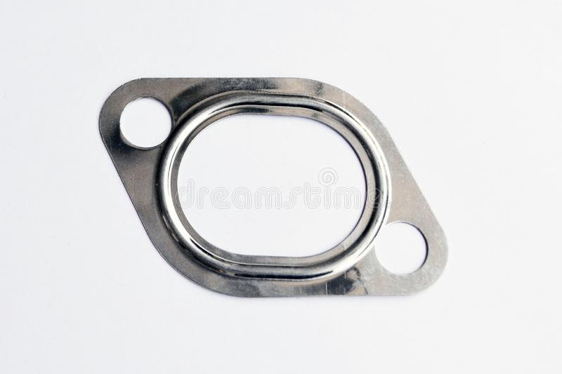 Automotive steel gasket for the. Exhaust system isolated on white background royalty free stock image