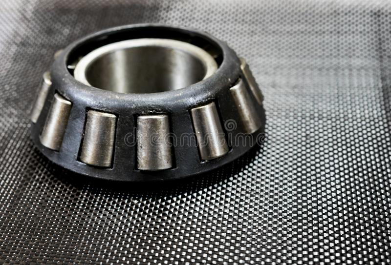 Automotive tapered roller bearing on carbon fiber. stock photo