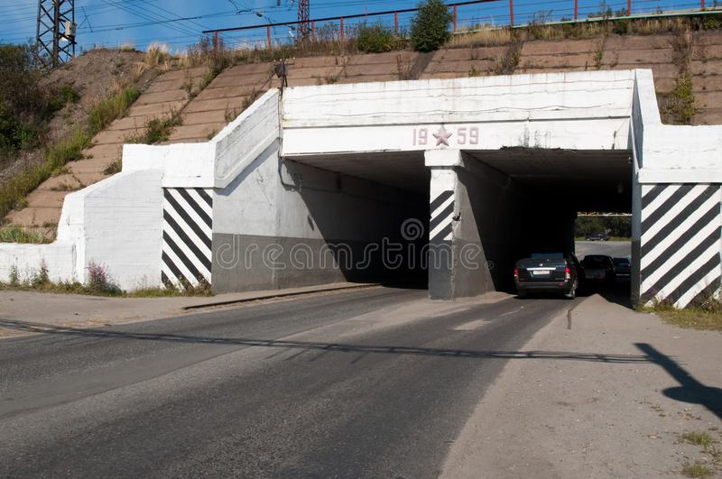 Automotive tunnel under the railway track. Kandalaksha, Russia - August 28, 2012: Automotive tunnel under the railway track stock images