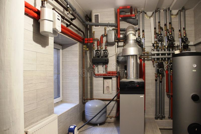 Autonomous heating system in the boiler room. boiler, water heater, expansion tank and other pipes. Selective focus stock photography