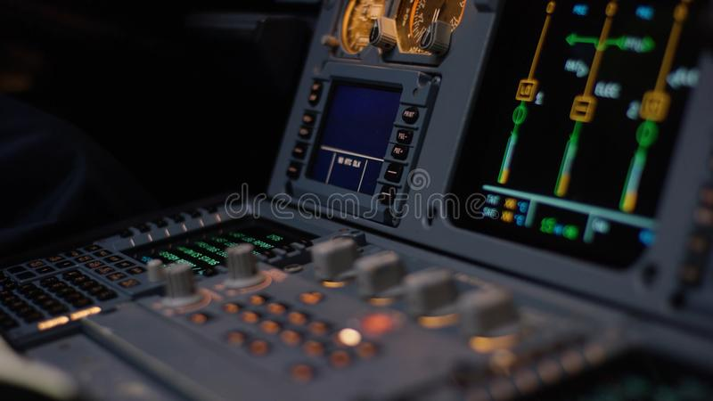 Autopilot control element of an airliner. Panel of switches on an aircraft flight deck. Thrust levers of a twin engined royalty free stock photos