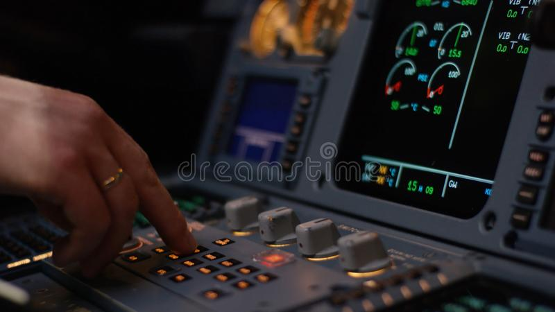 Autopilot control element of an airliner. Panel of switches on an aircraft flight deck. Thrust levers of a twin engined stock photography