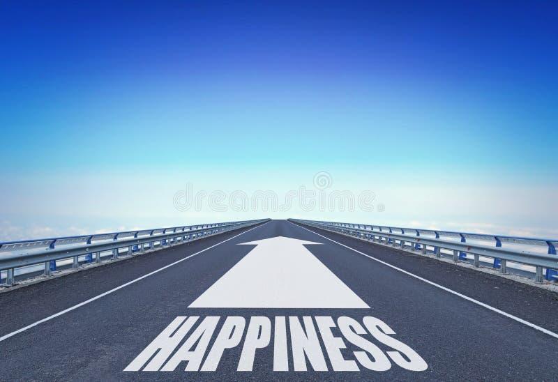 Autopista recta con una felicidad delantera de la flecha y del texto fotografía de archivo