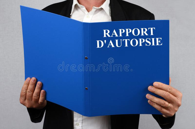 Autopsy report written in French. Unrecognizable man reading an autopsy report written in French vector illustration