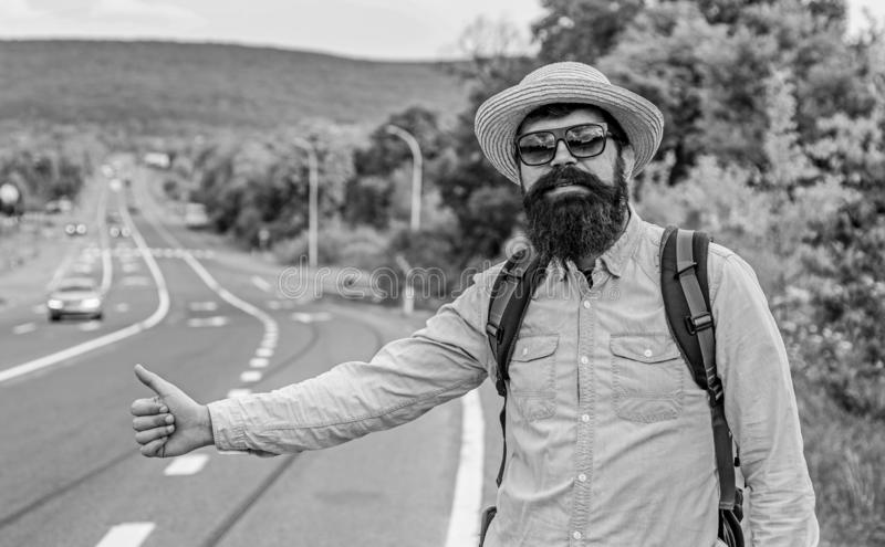 Autostop method. Man try stop car thumb up. Autostop alternative use ride sharing application. Hitchhiking one of. Cheapest ways traveling. Hitchhikers can meet stock photo