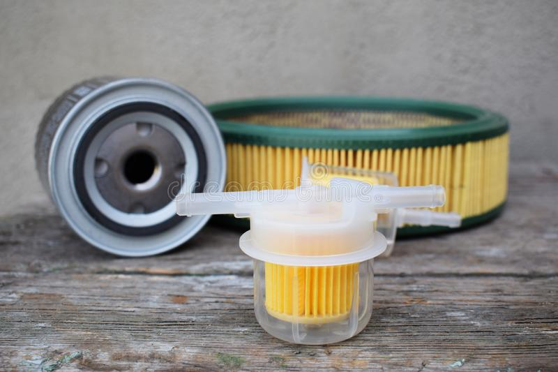 Autoteilzusätze: Öl, Brennstoff oder Luftfilter für Maschinenauto lizenzfreie stockfotografie