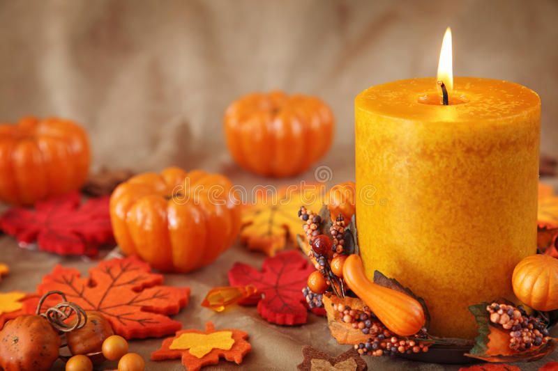 Autum candles. On a brown backdrop royalty free stock photo