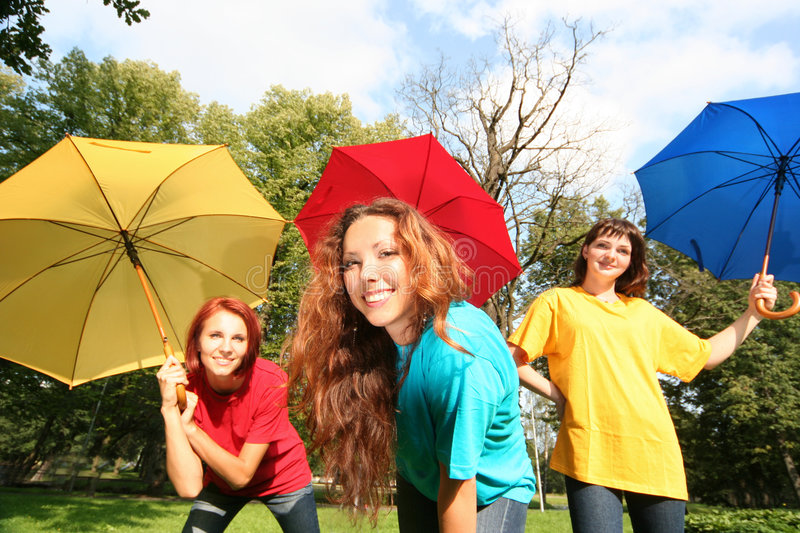 Autumn. Colorful friends having fun in park stock images
