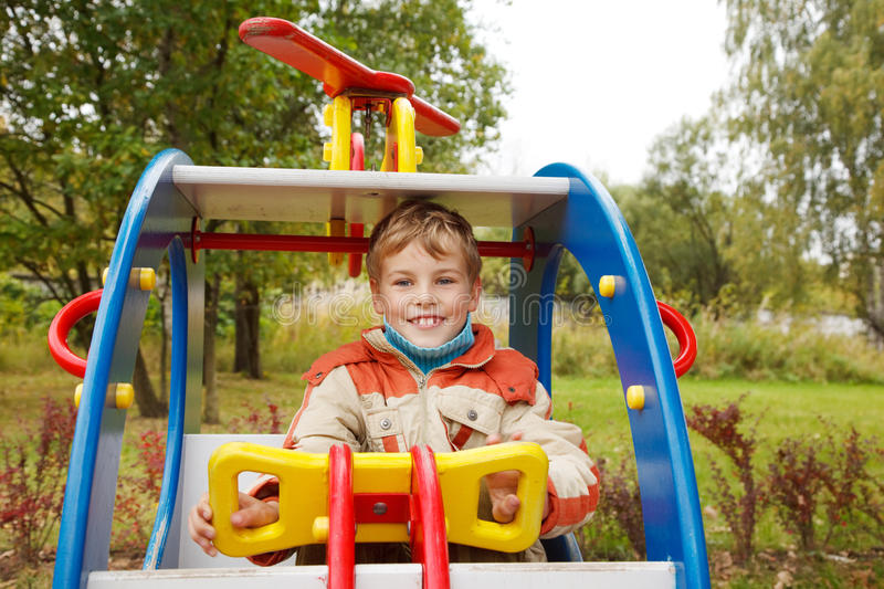 Download In Autumn Afternoon, Boy Plays On Playground Stock Photo - Image: 13803728
