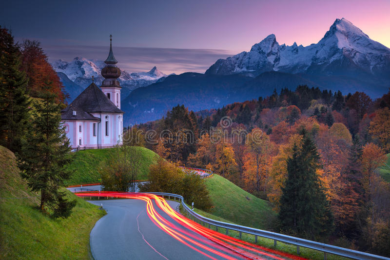 Autumn in Alps. Image of the european Alps with Maria Gern Church during beautiful autumn sunset stock images