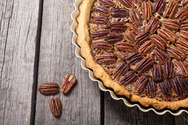 Autumn american pecan pie. Sweet dessert . Food background stock photography