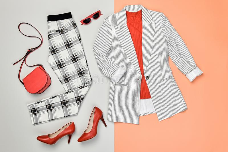 Autumn Fashion Clothes Flat lay, Leaf. Fall Outfit. Autumn Arrives. Fashion Lady Clothes fall Outfit. Trendy jacket, trousers. Stylish red Handbag, Glamour heels royalty free stock photography