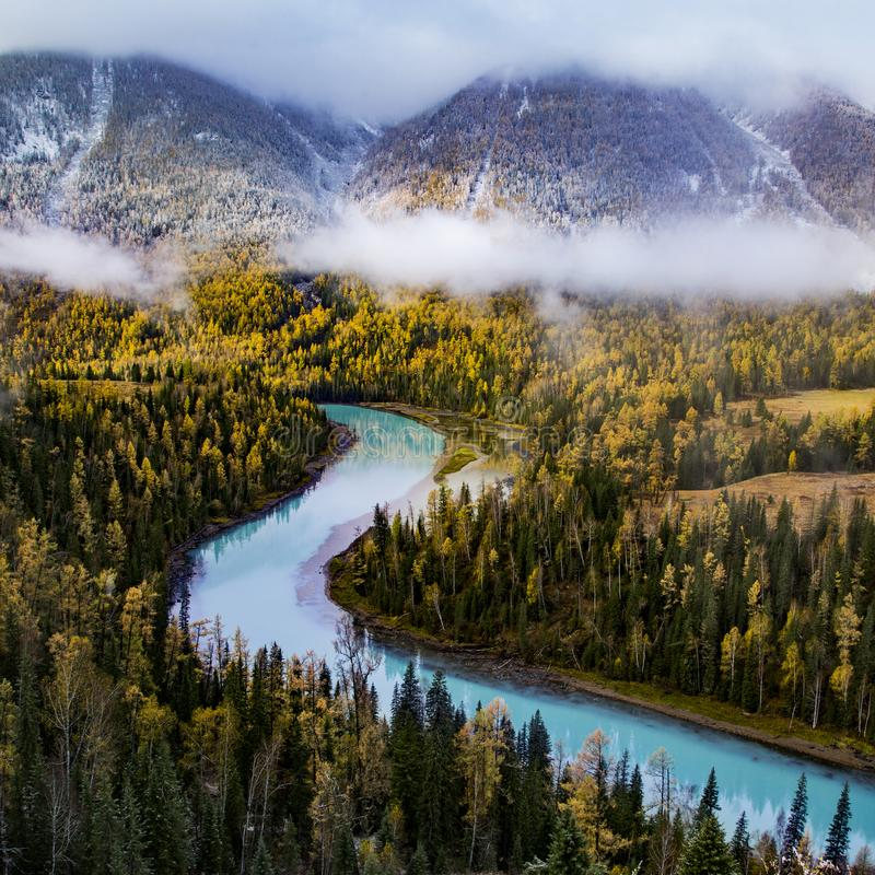 Autumn. In xinjiang,china,It`s snowing,Colorful,and beautiful stock photos