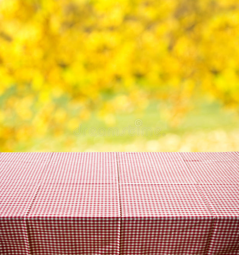 Autumn background. Empty wooden table against autumn background stock photography
