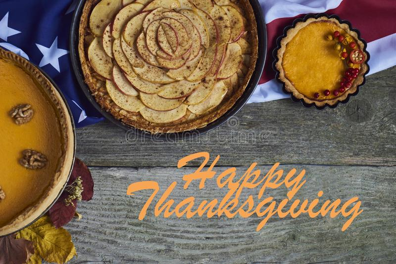 Autumn background. Homemade Pumpkin, apple Pies for Thanksgiving royalty free stock image