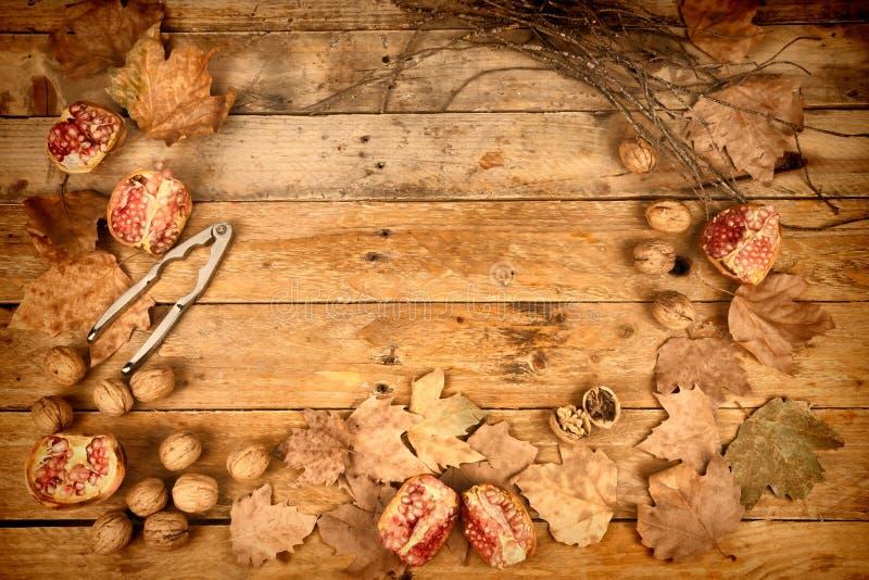 Autumn background with pomegranates royalty free stock photo
