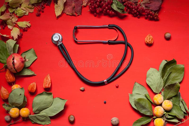 Autumn background stethoscope yellow leaves hospital z royalty free stock image