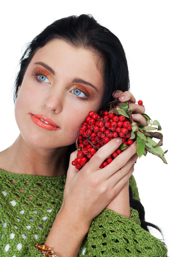 Autumn beauty. Girl with bunch of red rowanberry on isolated white royalty free stock images