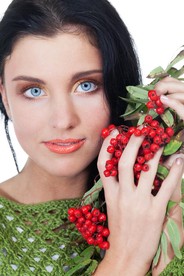 Autumn beauty. Girl with bunch of red rowanberry on isolated white royalty free stock photos