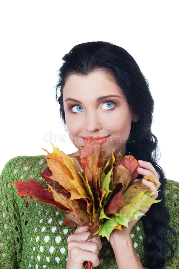 Autumn beauty. Girl with bunch of maple leaves on isolated white royalty free stock photography