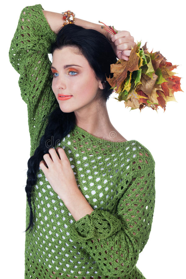 Autumn beauty. Girl with bunch of leaves on isolated white stock photography