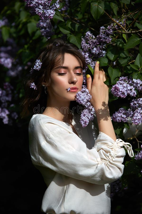 Free Autumn Beauty Portrait Of A Beautiful Girl In The Lilac Branches At Sunset. Lifestyle Woman With Natural Makeup In Nature With Royalty Free Stock Image - 158545536