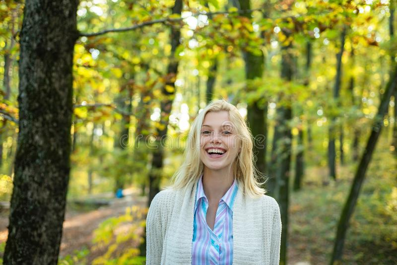 Autumn Beauty. Sweet young sensual sexy woman walking in autumn park. Autumnal mood. Cheerful carefree autumn woman in. Park on sunny day royalty free stock photo