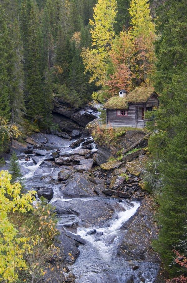 Autumn brook. Hut at a brook in autumn stock photo