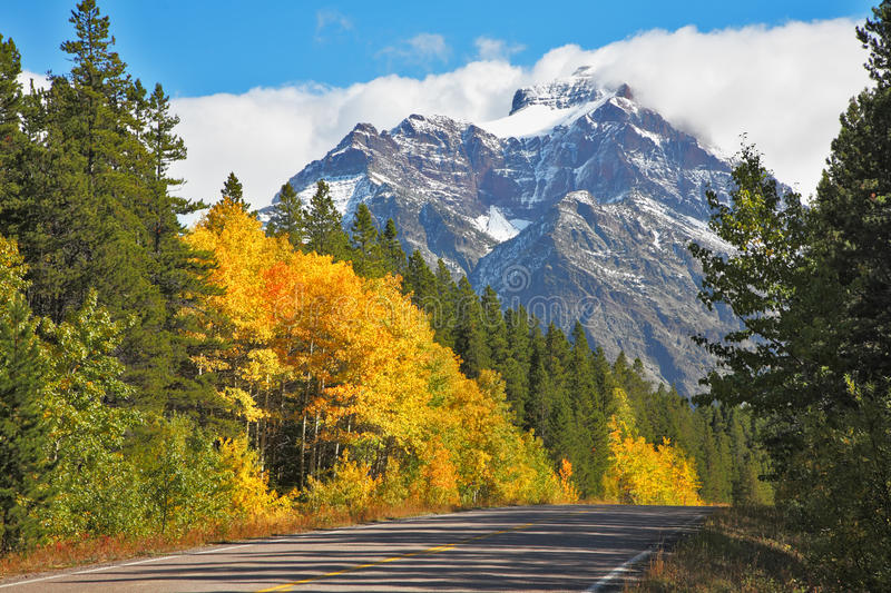Autumn in Canada. The road abruptly turns stock photos