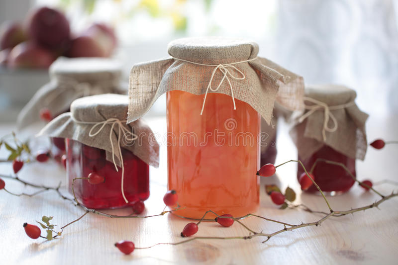 Autumn canning. Jars with jam on a wooden table royalty free stock photography