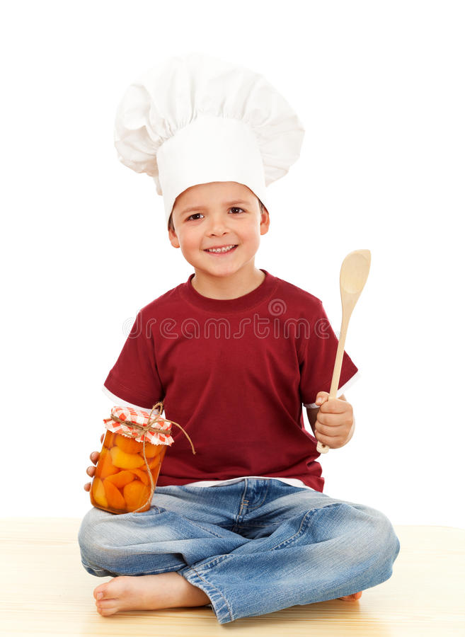Autumn canning. Happy boy stashing the summer goods stock images