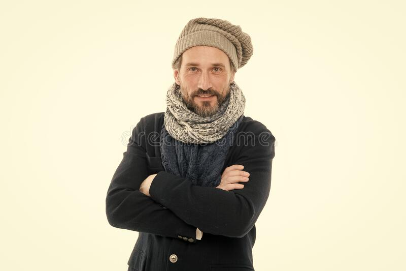 Autumn is chilly. Mature man keep arms crossed isolated on white. Bearded man feel cold in autumn fashion. Confident royalty free stock image