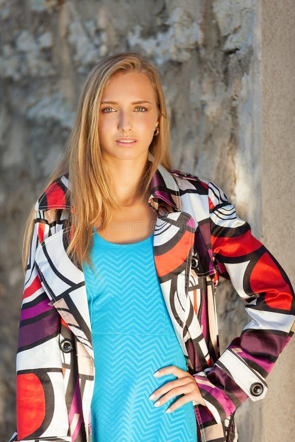 Autumn city fashion. Fashionable woman in stylish coat stock photography